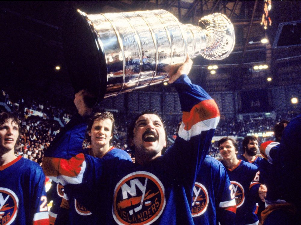 bryan-trottier-holds-the-stanley-cup-above-his-head-during-t3 Bryan Trottier Bryan Trottier New York Islanders Pittsburgh Penguins